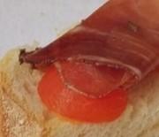 Bruschetta speck, scamorza e pomodoro